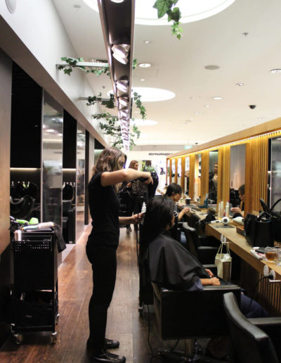 hair stylist at work in Tribe Lifestyle salon Sydney CBD
